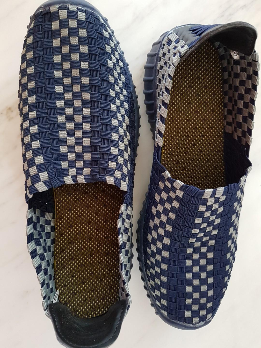 Rubber sole slip on blue shoes with weaved top