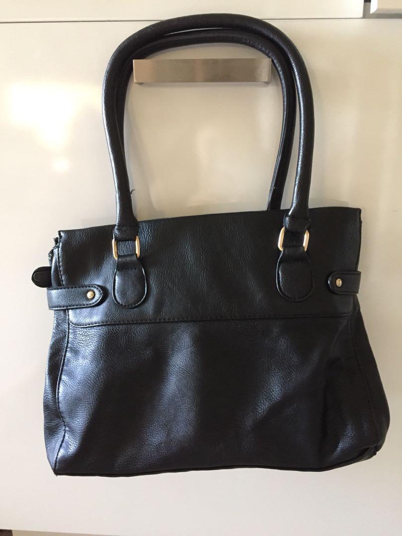 Rubi Black Handbag with gold zipper and detailing fixtures