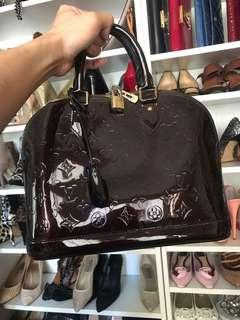 Pre owned Louis Vuitton alma in amarante