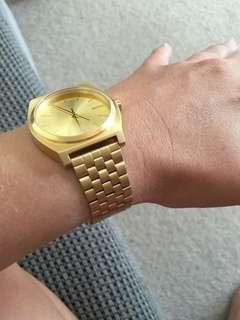 Nixon gold watch - time teller