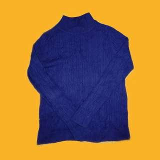 blue knitted turtleneck sweater