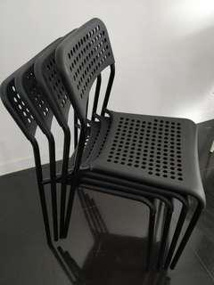 Set of four black Adde chairs