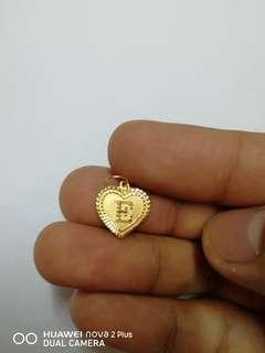 Loket emas 916 huruf E