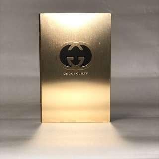 GUCCI guilty gold metal notebook