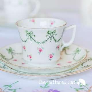Pretty antique English china trio, bows, swags and ditsy pink roses