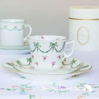 Slightly imperfect but pretty no less: antique English china trio, bows, swags and ditsy pink roses