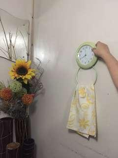 Wall clock with towel holder