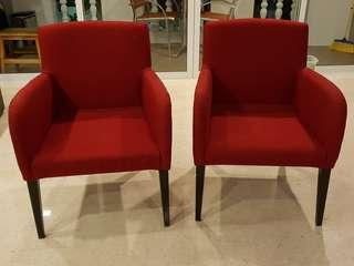 Red upholstered armchairs