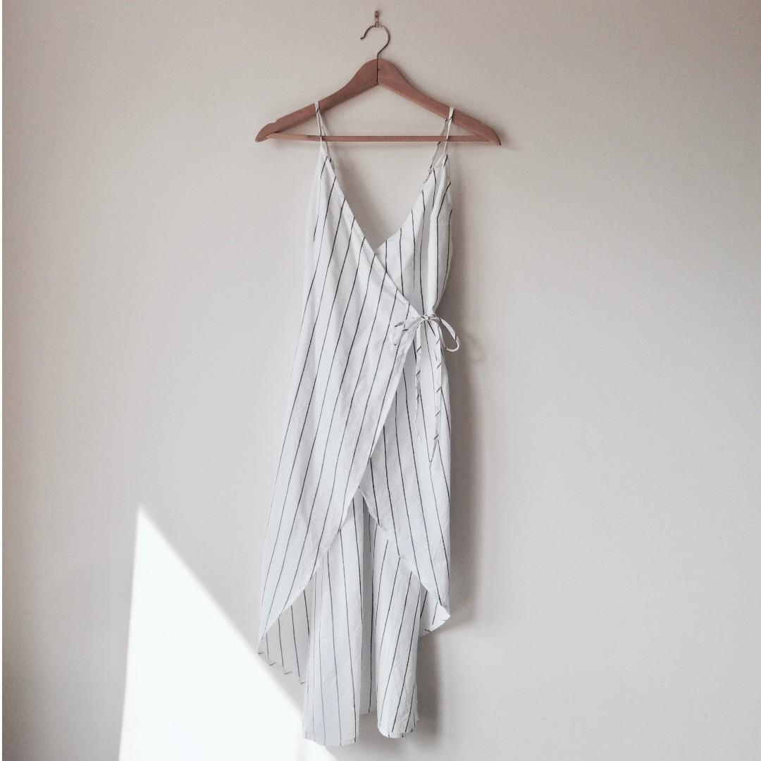 Alice in the Eve white linen wrap dress