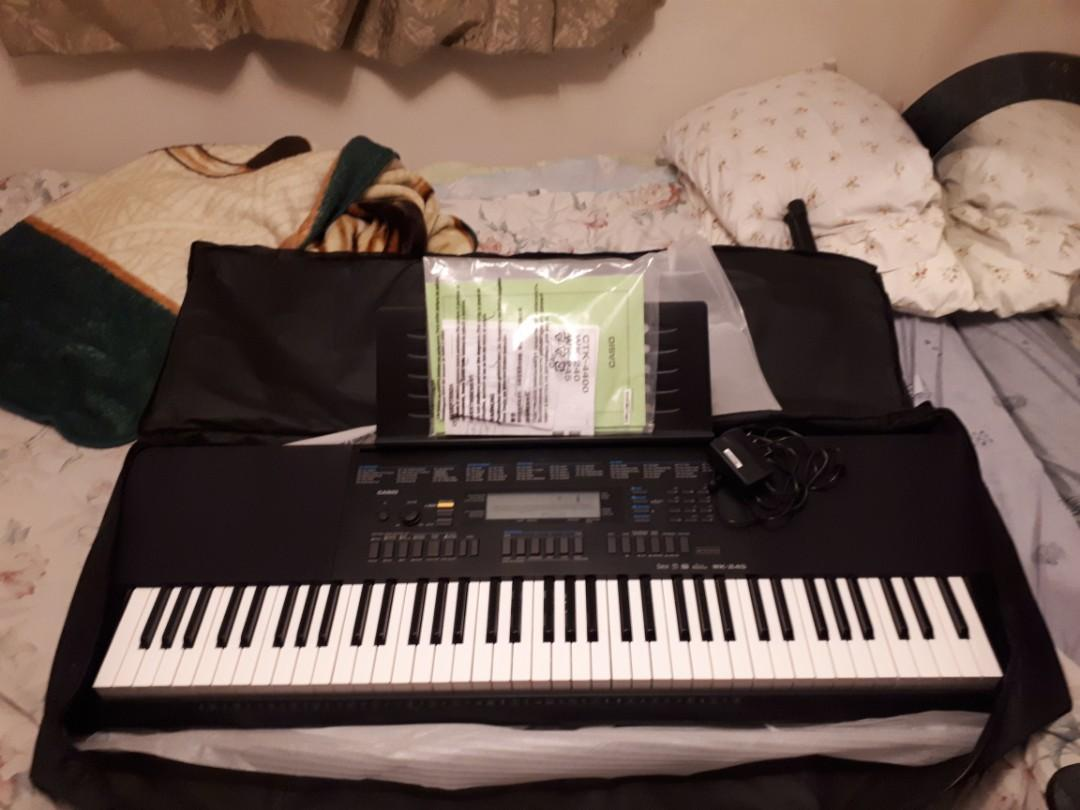 Selling a brand new Casio WK-245DXAB keyboard piano bundle