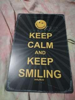 Keep Calm and Keep Smiling stainless steel sign