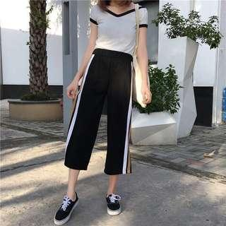 BLACK CULOTTES WITH SIDE STRIPES