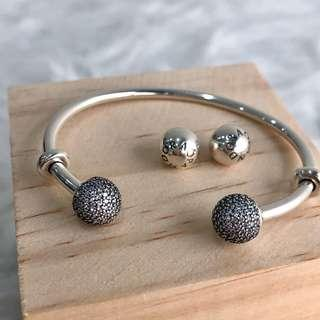 Pave caps open bangle with additional signature cap