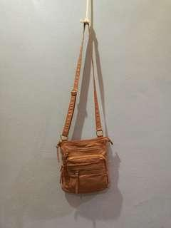 Dusty pink soft leather sling bag