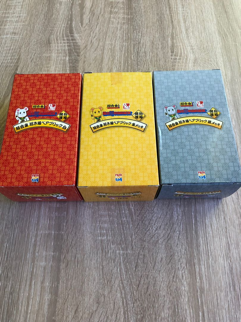 5c695c37 Bearbricks 200% Chogokin metal Lucky Cats in gold, silver and white ...