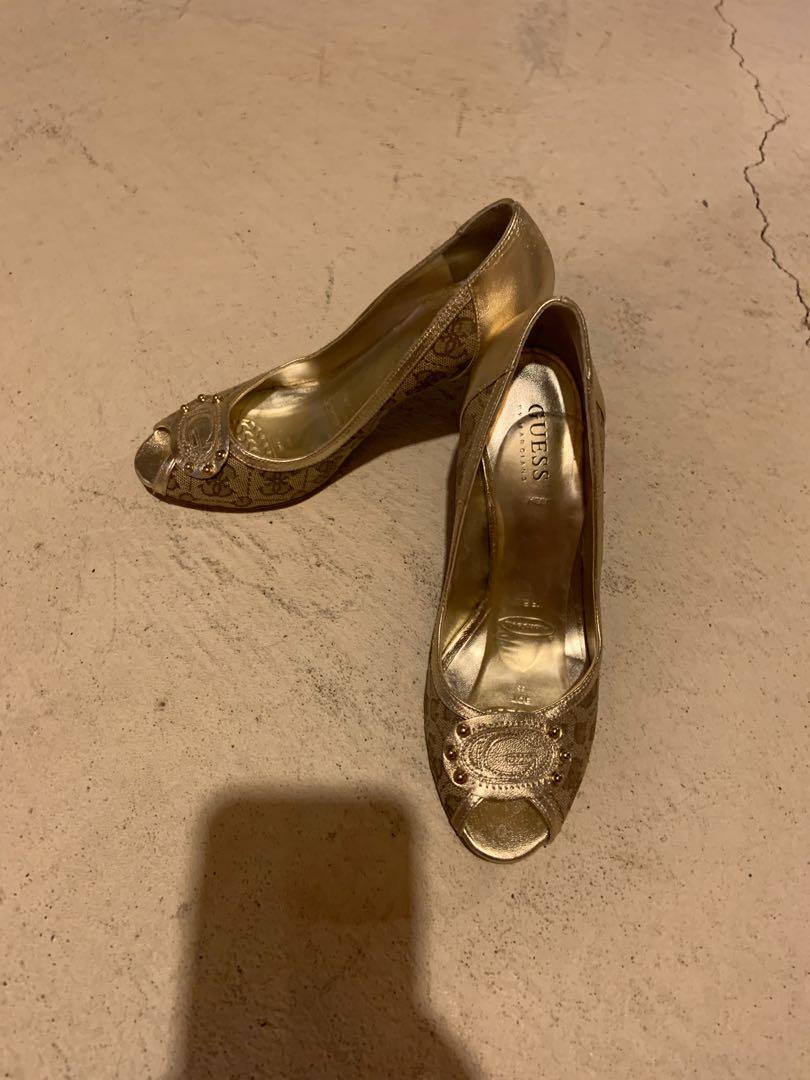 Beautiful gold colour guess heels. Size 7. Excellent condition
