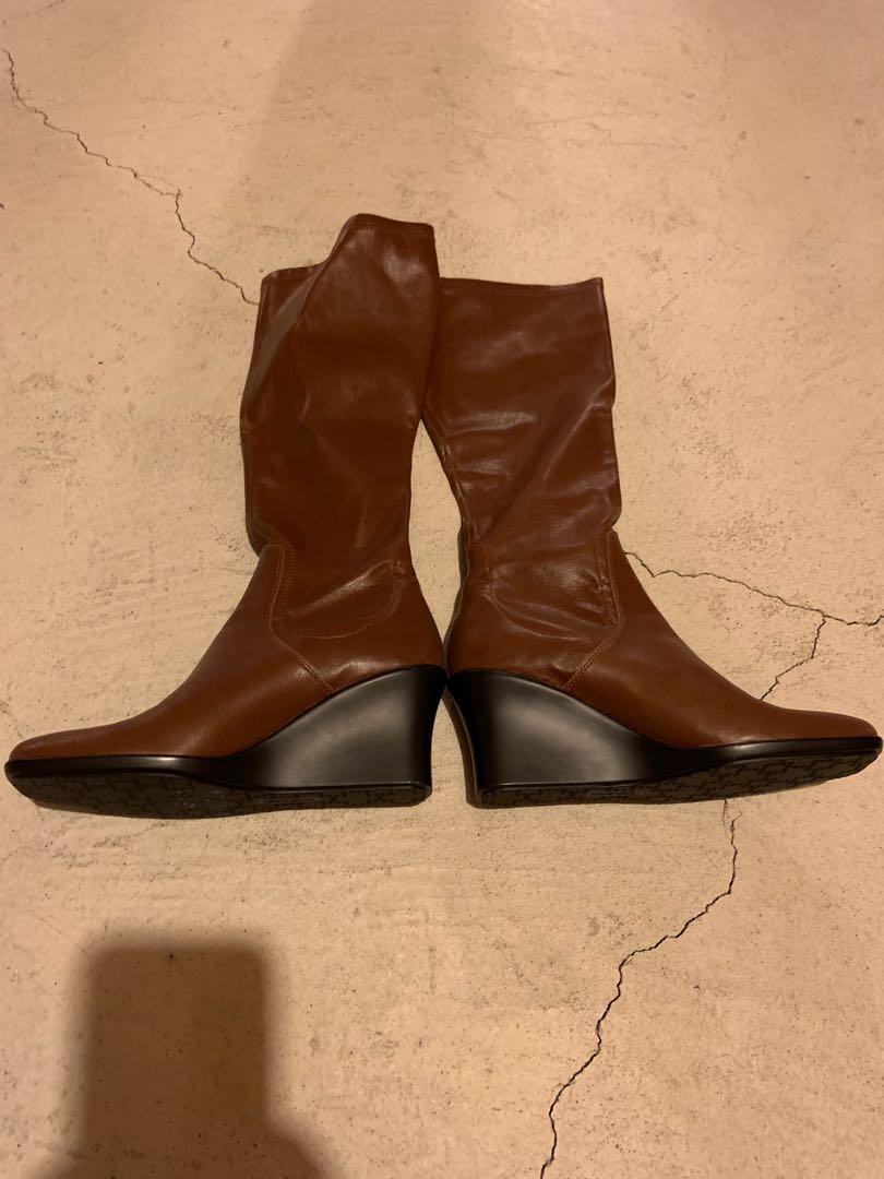 Brand new in box Nine West long boots. Goes great with skirts, leggings and jeans.  Size 6.5