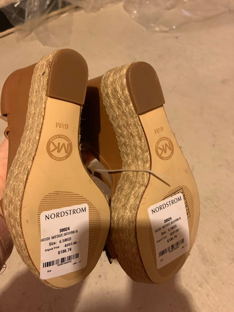 Brand new Michael Kors summer wedges. Size 6.5. Retails for $278