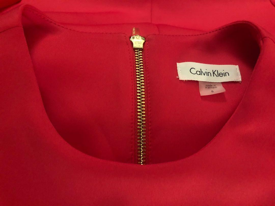 Brand new red Calvin Klein dress, very good quality. Never worn. Size 6