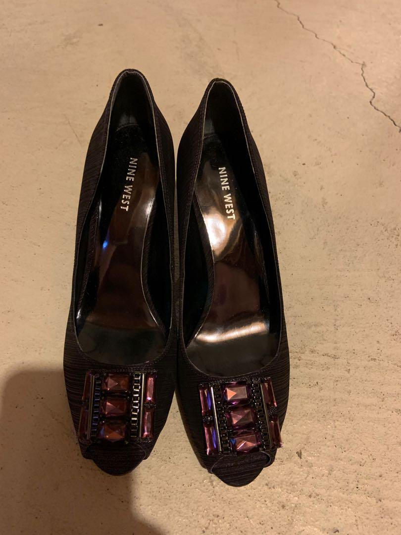 Like new. Nine West purple peep toe heels. Perfect for completing an evening look.