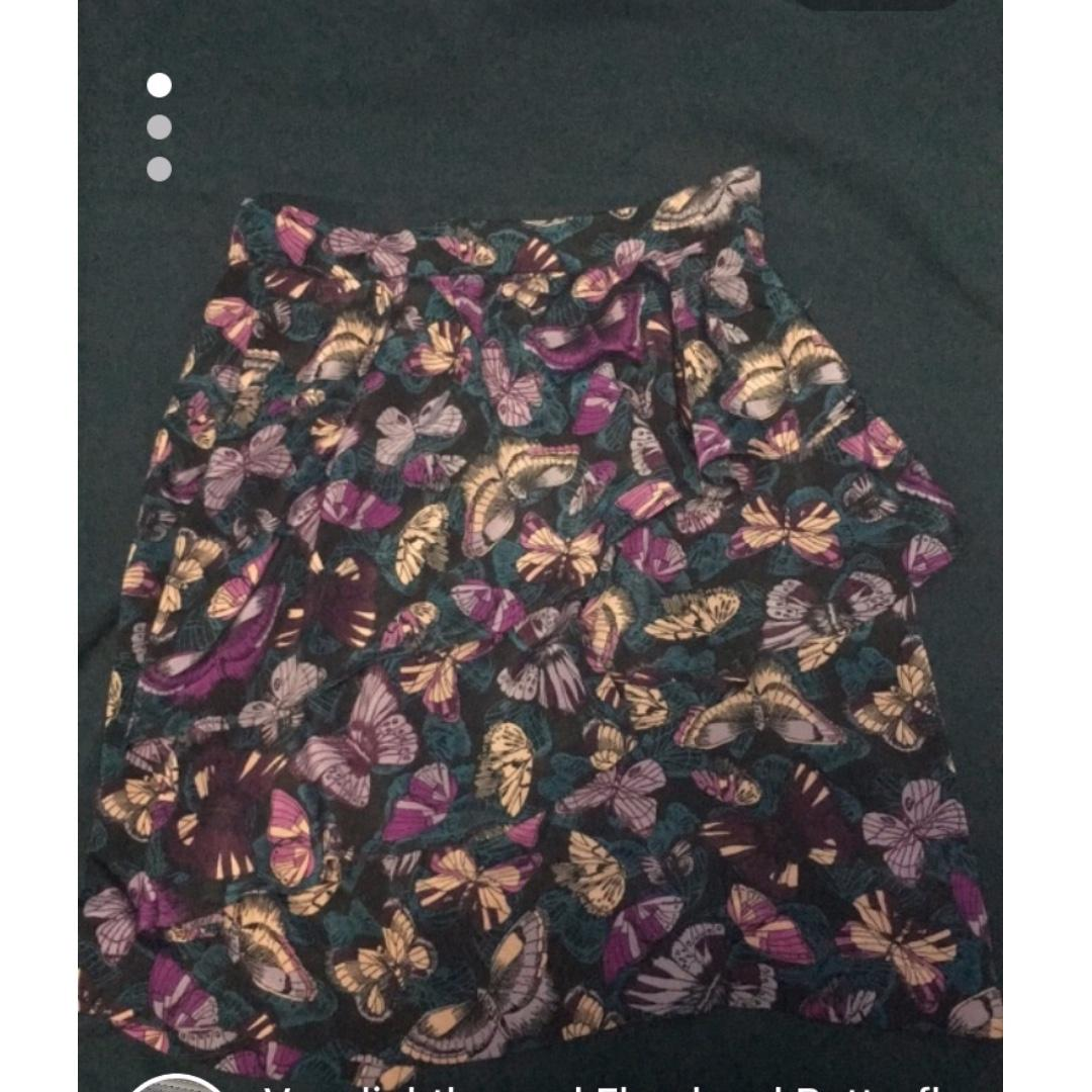 Very lightly used (worn 4-5 times) Floral Butterfly Ruffle Skirt - Size 2