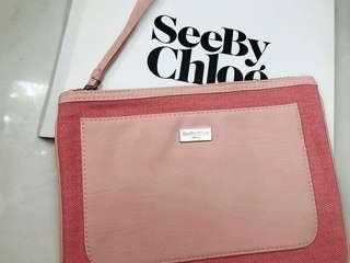 See by Chloe pink clutch