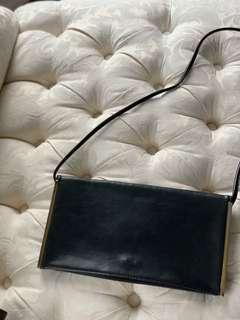 Black thin leather bag with gold outlining