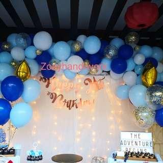 Balloon garlands with fairy lights backdrop