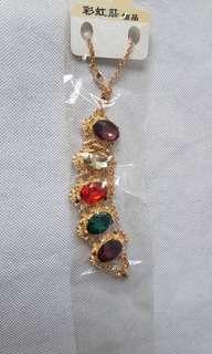 Woman colourful crystal studded stones necklace