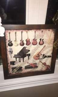 Decorate art frame with musical instruments