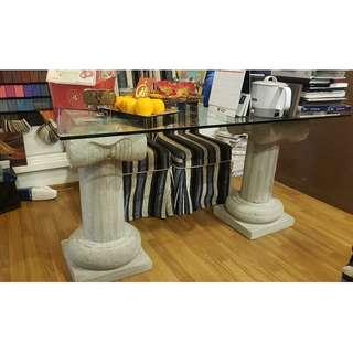glass top table with roman stone design stand
