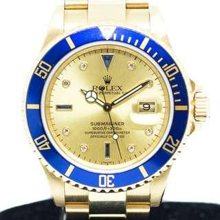 Preowned Rolex Submariner Blue Serti in Yellow Gold 16618
