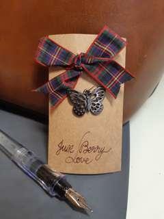 UK butterfly pendant