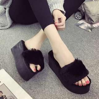 Furry black platform slippers