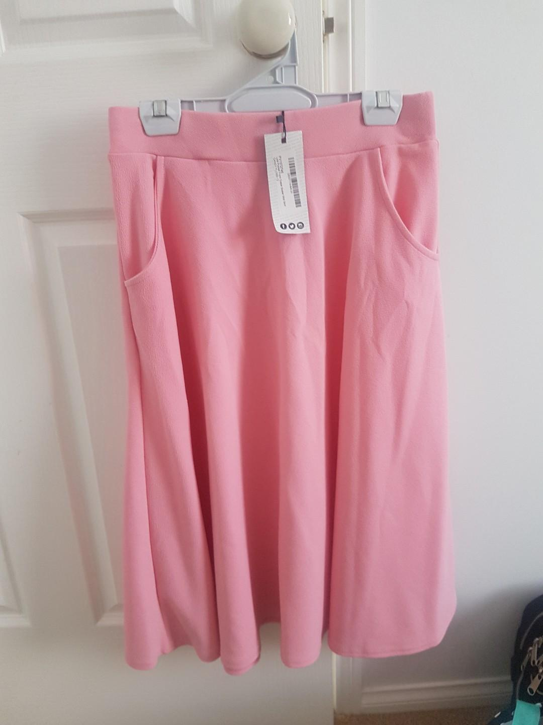 Candy floss pink midi skirt with pockets