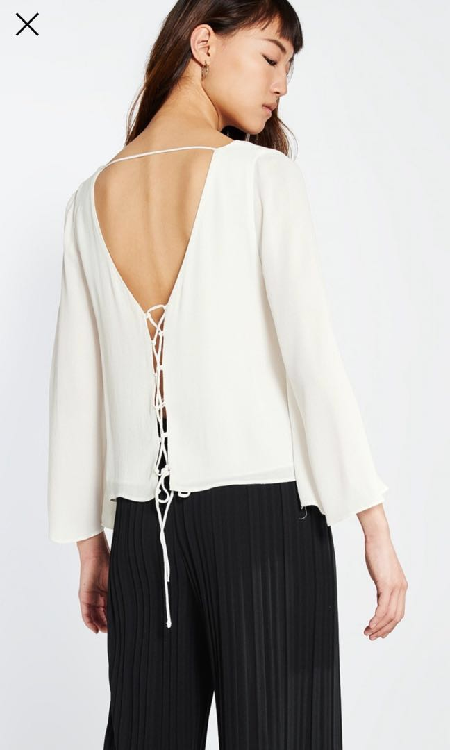 a65c975b6b3de Pomelo White Bell Sleeve Top with lace up back