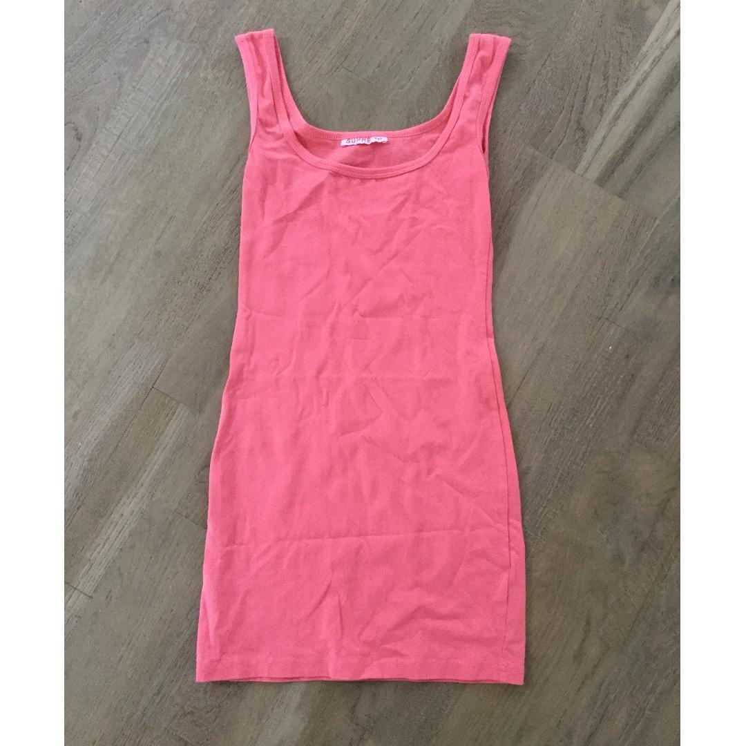 Size xxs tight fitted dress, salmon colour, excellent condition