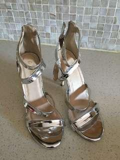 Ladies silver strapped heels
