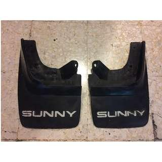 A Pair of Nissan Sunny 130Y Special Edition Mud Guards & Nissan Emblem