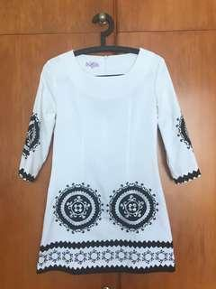White dress with black embroidery
