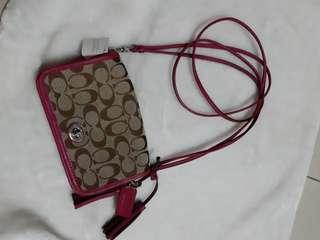 Bnew coach monogram mini sling bag