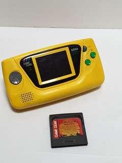 Sega game gear yellow game console