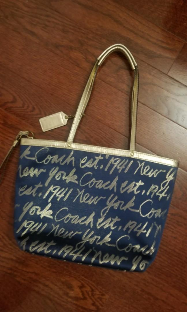 Navy blue and gold Coach bag