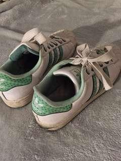 Green striped Adidas shoes