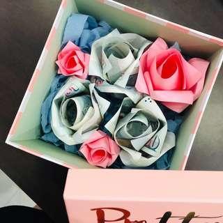 Money valentine's day flower bouquet in a box