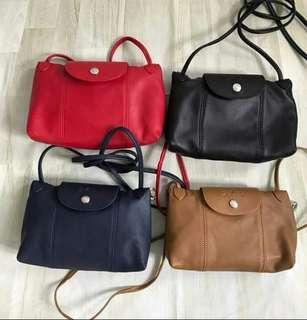 ba303607a34a3 Longchamp Le Pliage Cuir Crossbody Bag