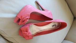 Peach pink shoes