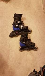 Barely used kids rollerblades (size 12-2)