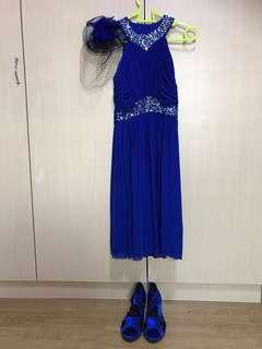 Halter neck blue dress  (2) 1 pair of shoes (3) head gear