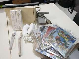 Used Full package of Nintendo Wii with over 100 games